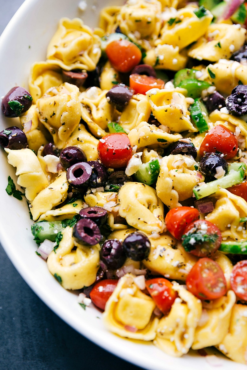U- close image of Greek Tortellini Salad, dressed and ready to be eaten