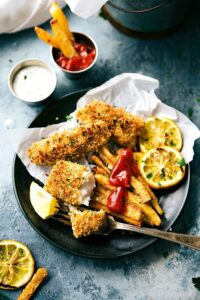 ONE PAN easy fish and chips -- the crispiest baked fries you'll ever eat and delicious fish! Simple prep. via chelseasmessyapron.com
