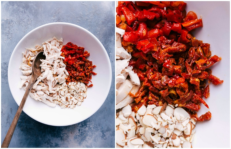 Process shot-- image of the chicken, slivered almonds, roasted red peppers, and tomatoes in a bowl for Pesto Chicken Salad.