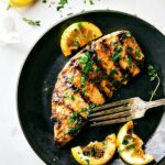 The absolute best chicken marinade recipe with a delicious honey lemon sauce. This grilled honey lemon chicken is quick to make and sure to be a huge hit!