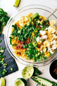 A delicious Mexican Street Corn Pasta salad with tons of veggies and a simple creamy dressing. Recipe from chelseasmessyapron.com