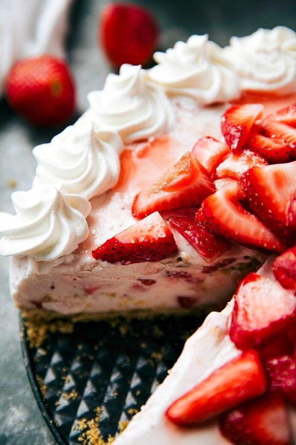 FIVE ingredient frozen strawberry cheesecake ice cream pie with a buttery graham cracker crust and 2 ingredient strawberry cheesecake filling. Recipe via chelseasmessyapron.com