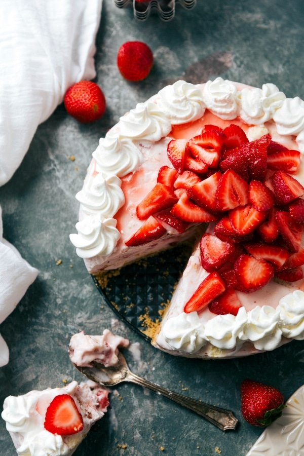 A simple FIVE ingredient frozen strawberry cheesecake ice cream pie with a buttery graham cracker crust and 2 ingredient strawberry cheesecake filling. Recipe via chelseasmessyapron.com