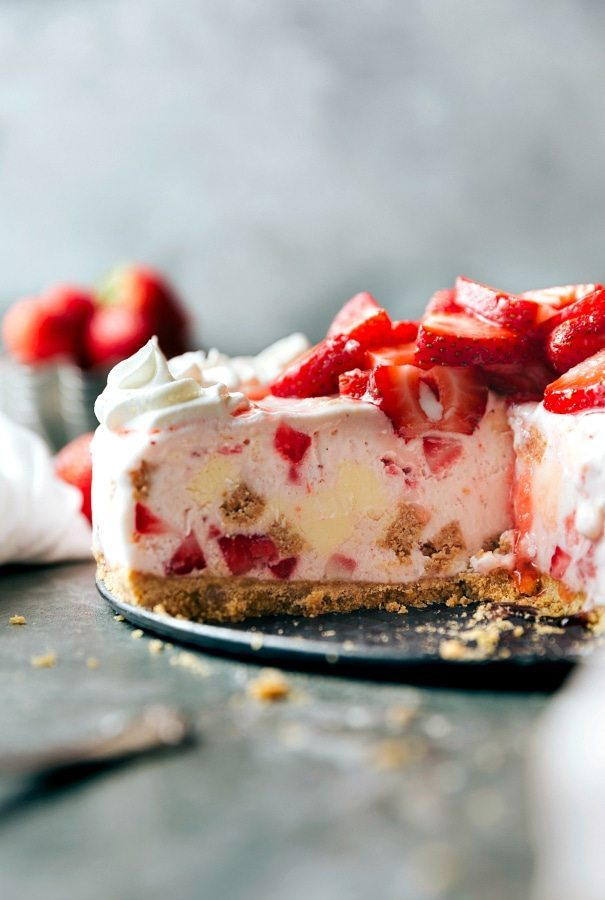 FIVE ingredient frozen strawberry cheesecake ice cream pie with a buttery graham cracker crust and 2 ingredient strawberry cheesecake filling. Recipe from chelseasmessyapron.com