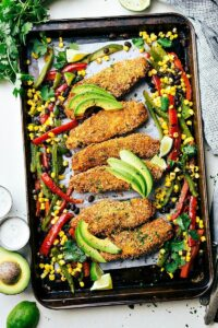 Mexican tortilla crusted chicken baked on one pan with plenty of veggies! A delicious, hearty, and healthy meal the whole family will love!