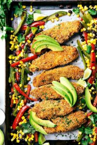 Mexican tortilla crusted chicken baked on one pan with plenty of veggies! Via chelseasmessyapron.com