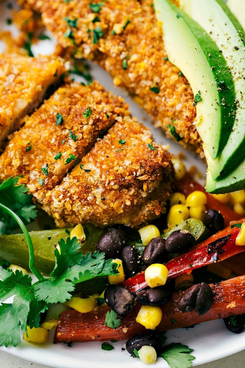 ONE PAN for this Mexican tortilla crusted chicken baked on one pan with plenty of veggies! A delicious, hearty, and healthy meal the whole family will love!