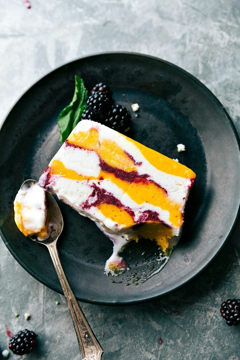 Only FIVE ingredients and a bread pan needed to make this impressive looking and beautiful dessert consisting of sorbet, frozen fruit, and vanilla bean ice cream. A show-stopping SORBET SLICE dessert that couldn't be easier to make! Via chelseasmessyapron.com