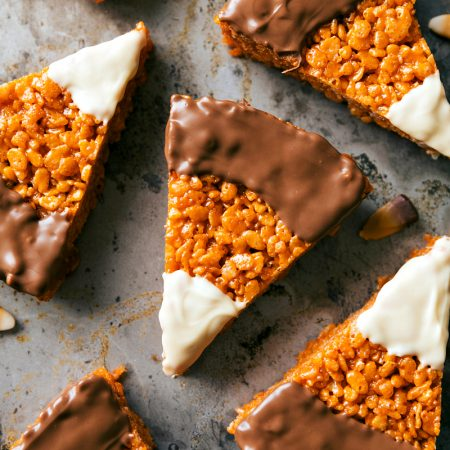 the-absolute-best-peanut-butter-krispie-treats-decorated-to-look-like-candy-corns-with-melted-white-and-milk-chocolate-topping-recipe-via-chelseasmessyapron-com
