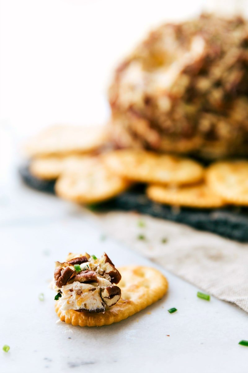A five-minute, easy appetizer! This bacon-ranch, pecan-coated cheeseball is sure to be a hit at any party! Recipe from chelseasmessyapron.com