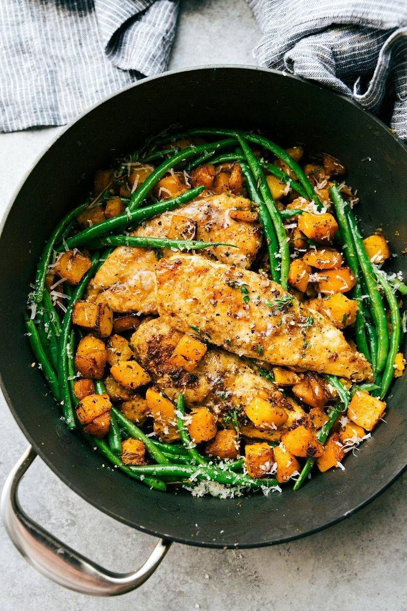 An EASY and delicious pan seared chicken, butternut squash, and green bean skillet dinner. An easy, family-friendly, 30-minute meal! via chelseasmessyapron.com