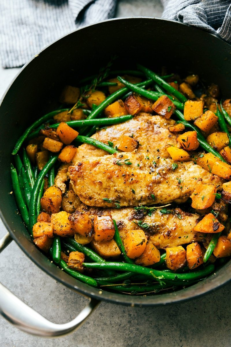 A delicious pan seared chicken, butternut squash, and green bean skillet dinner. An easy, family-friendly, 30-minute meal! via chelseasmessyapron.com