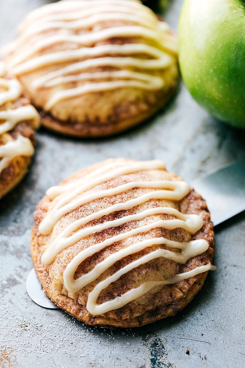 Delicious and flakey hand apple pies made for dipping in a thick, rich, and creamy caramel sauce! via chelseasmessyapron.com