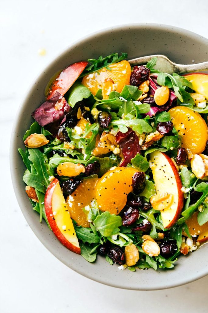 a-delicious-candied-almond-mandarin-and-apple-salad-with-an-orange-poppyseed-dressing