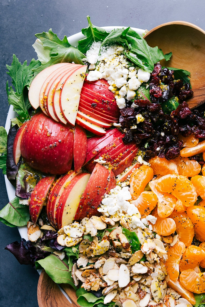 Overhead view of the apples, feta, cranberries, mandarin oranges and candied almonds that top this scrumptious salad.