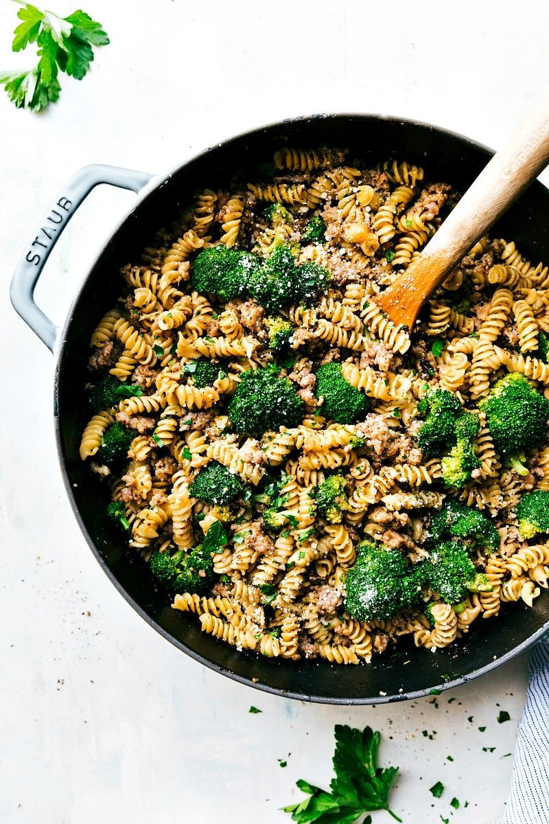 An easy, delicious, wholesome dinner of herb and parmesan pasta, ground Italian sausage and broccoli all made in just ONE pan! chelseasmessyapron.com