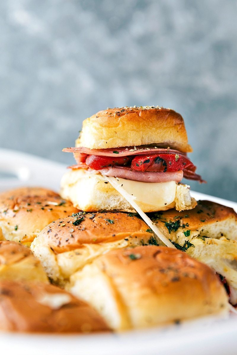 EASY BAKED ITALIAN SLIDERS! Easy baked Italian sliders with ham, salami, pepperoni, roasted red peppers, and provolone. These sliders are so quick, easy, and make the perfect appetizer! via chelseasmessyapron.com