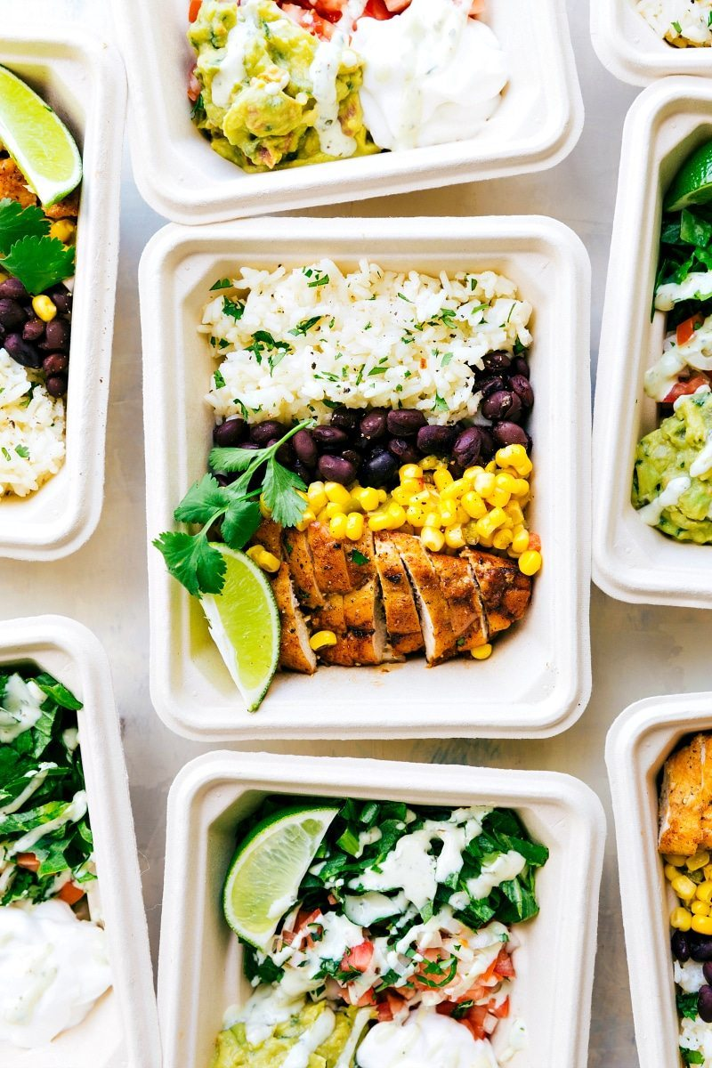 EASY MEAL PREP Chicken Burrito Bowls!! Tons of short-cuts for a better than a restaurant burrito bowl! Taco-seasoned chicken, cilantro-lime rice, salsa, guac, beans, and a creamy cilantro sauce! Recipe from chelseasmessyapron.com