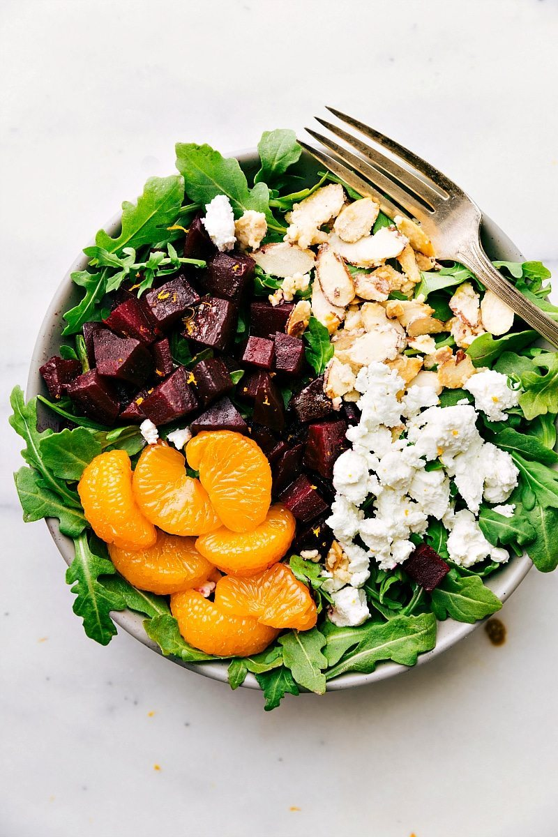 Image of the roasted beet and goat cheese salad ready to eat with a fork on the side