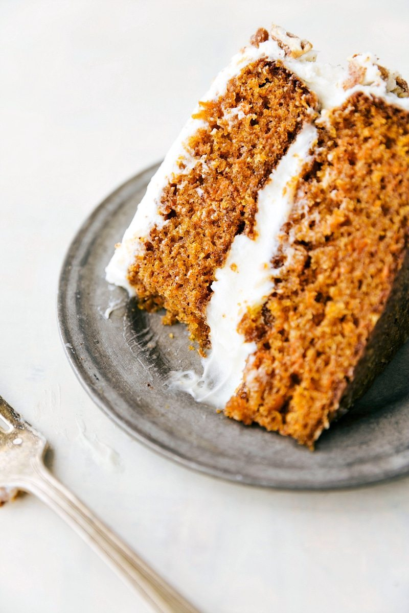 The ULTIMATE BEST EVER carrot cake! Dozens were tested to bring you this amazing recipe! PLUS a fun twist of adding candied pecans to the sides!! via chelseasmessyapron.com