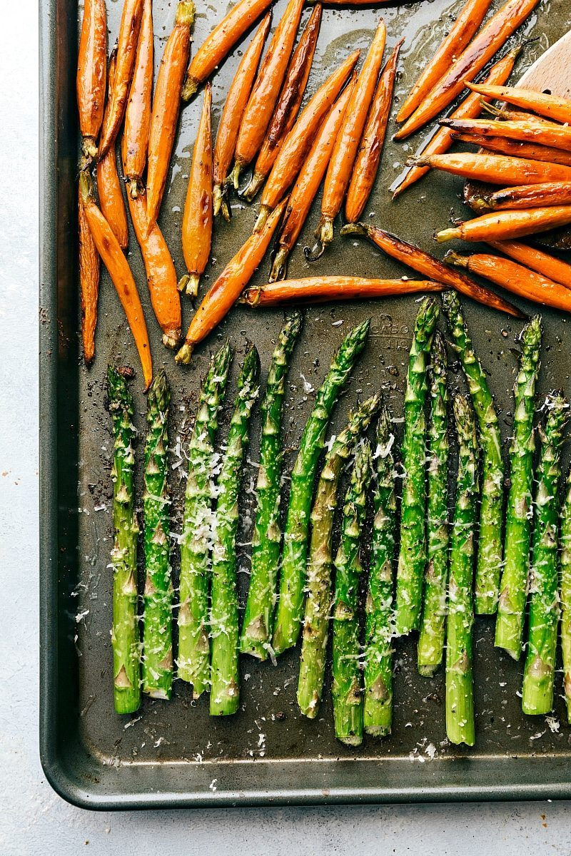 Image of the sheet pan with carrots and asparagus that goes with this easter dinner meals