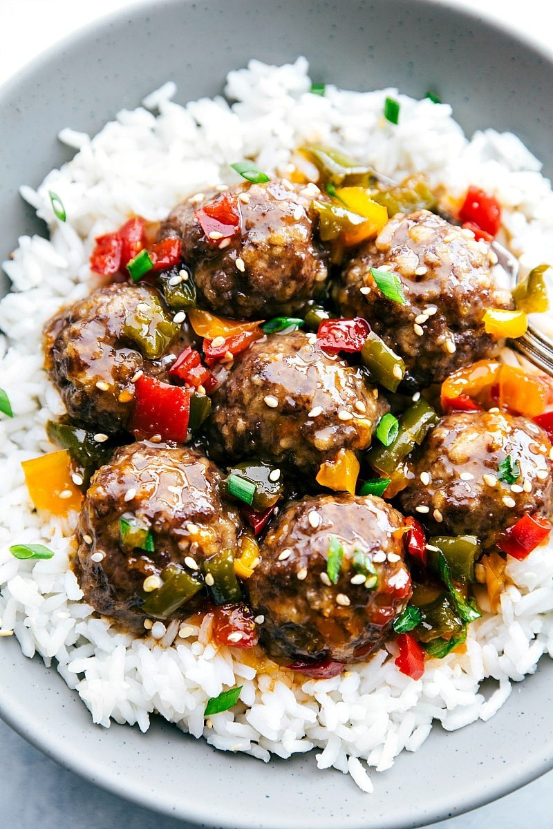 SWEET AND SOUR MEATBALLS!! CROCKPOT or oven-made Asian Meatballs with the BEST sweet and sour sauce! Easy dinner recipe via chelseasmessyapron.com and Oh Sweet Basil Cookbook