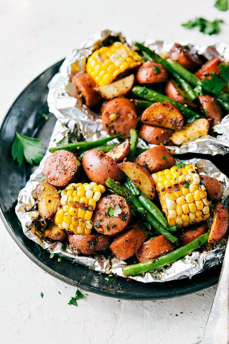 Foil Pack Sausage and Veggies! Easy Tin Foil Pack Garlic Butter Sausage and Veggies. A delicious meal that takes 15 minutes prep time or less! chelseasmessyapron.com