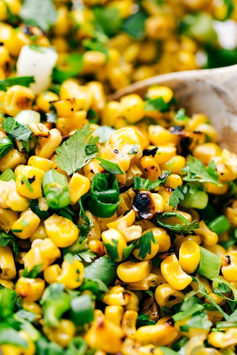 "Easy and Healthy ""Mexican Street Corn"" Burrito Bowls! This healthy and delicious meal brought to you by chelseasmessyapron.com"