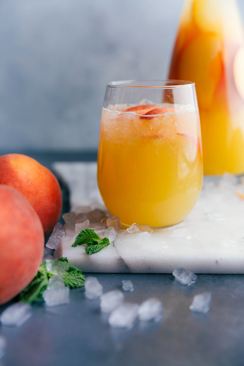 Image of Peach Lemonade with sliced peaches for garnish.