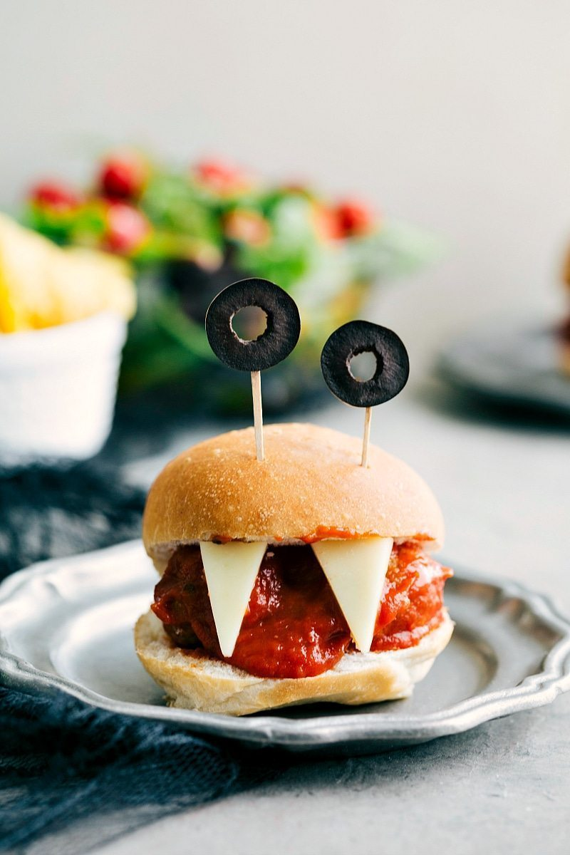 Image of the Monster Meatball Sliders with olive eyes and cheese teeth that go along with these halloween appetizers easy to make