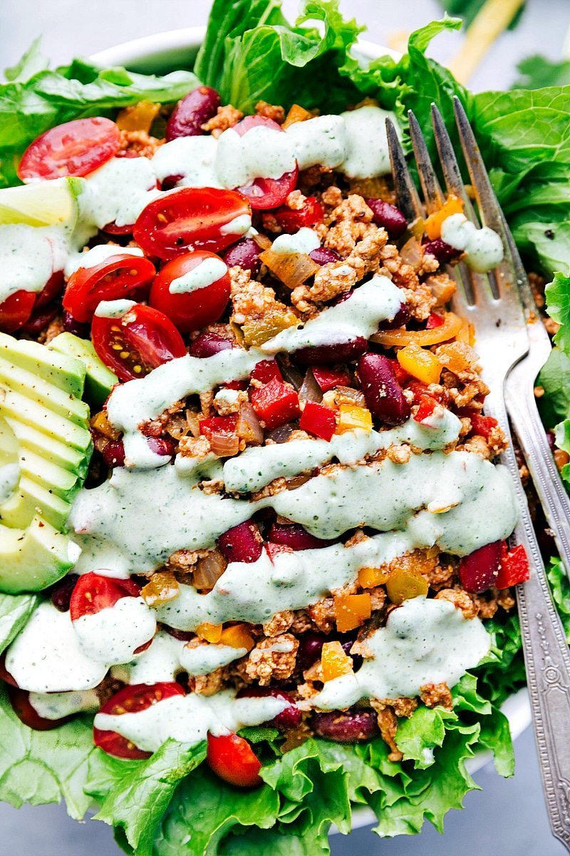 Image of the del taco turkey taco salad re-make with the cilantro dressing on it and ready to eat