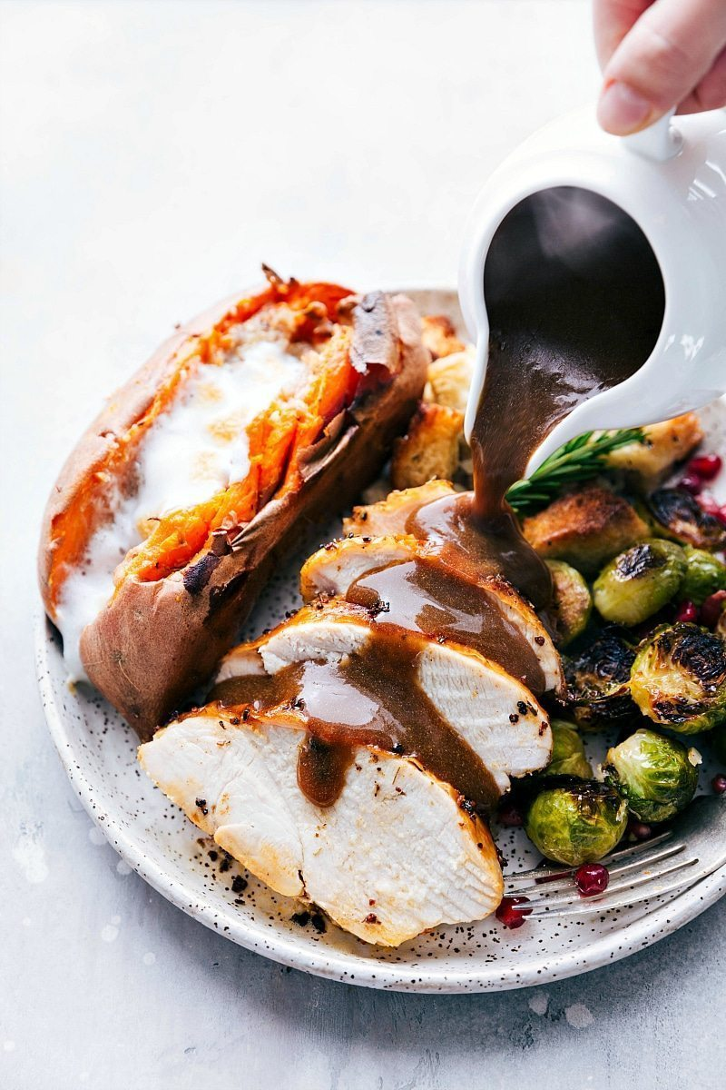 An ENTIRE Thanksgiving Dinner (turkey breast + gravy, candied sweet potatoes, dressing, and parmesan brussels sprouts) all made on two sheet pans. I chelseasmessyapron.com I #thanksgiving #dinner #sheetpan #brussels #sweetpotato #dressing #easy #quick #turkey #turkeybreast #candiedpotatoes #gravy