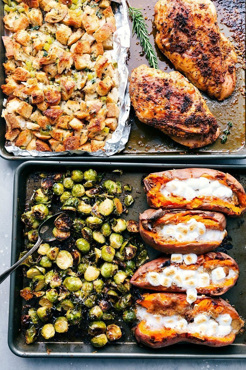 An ENTIRE Thanksgiving Dinner (turkey breast + gravy, candied sweet potatoes, dressing, and parmesan brussels sprouts) all made on two sheet pans. I chelseasmessyapron.com I #thanksgiving #dinner #sheetpan #brussels #sweetpotato #dressing #easy #quick