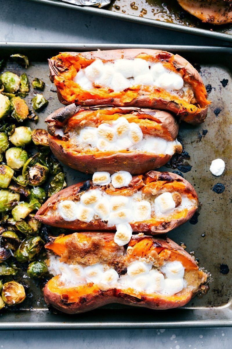 An ENTIRE Thanksgiving Dinner (turkey breast + gravy, candied sweet potatoes, dressing, and parmesan brussels sprouts) all made on two sheet pans. I chelseasmessyapron.com I #thanksgiving #dinner #sheetpan #brussels #sweetpotato #dressing #easy #quick #turkey #turkeybreast #candiedpotatoes