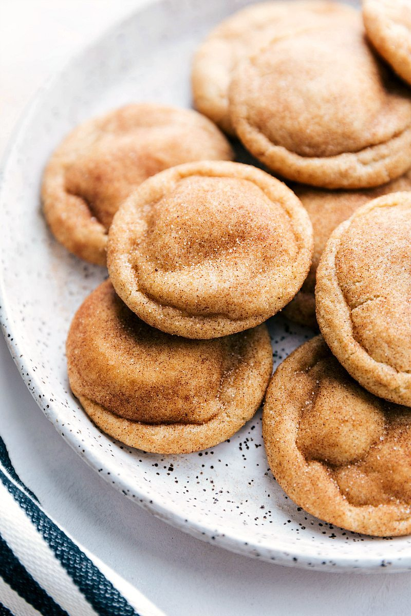 The ultimate BEST EVER SNICKERDOODLE COOKIES! Crisp edges, soft and chewy center, and SO much flavor! These are the BEST EVER! Recipe via chelseasmessyapron.com | #snickerdoodle #cookie #dessert #bake #baking #treat #holiday #cookies #christmas #cinnamon #sugar #easy #video #tutorial #best #popular #snickerdoodlecookie #party #easy