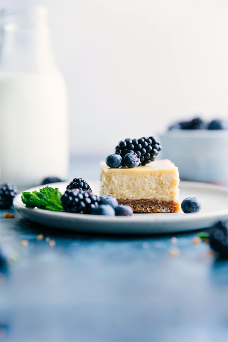 Image of a square of the cheesecake bars on a plate