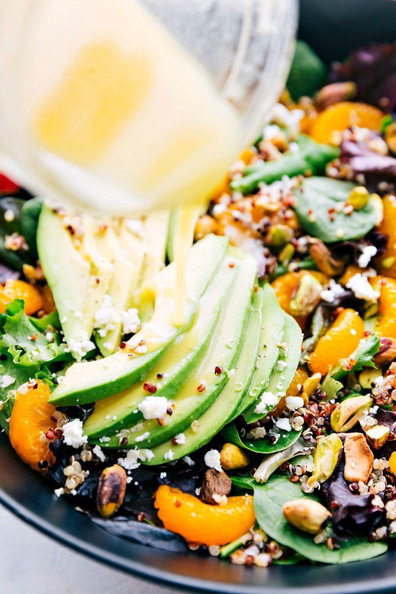 DELICIOUS powerhouse AVOCADO QUINOA SALAD with the best healthy dressing! via chelseasmessyapron.com | #salad #quinoa #mixedgreens #lettuce #healthy #protein #vegetarian #easy #quick #familyfriendly #orange #avocado #nutrition #health #wellness