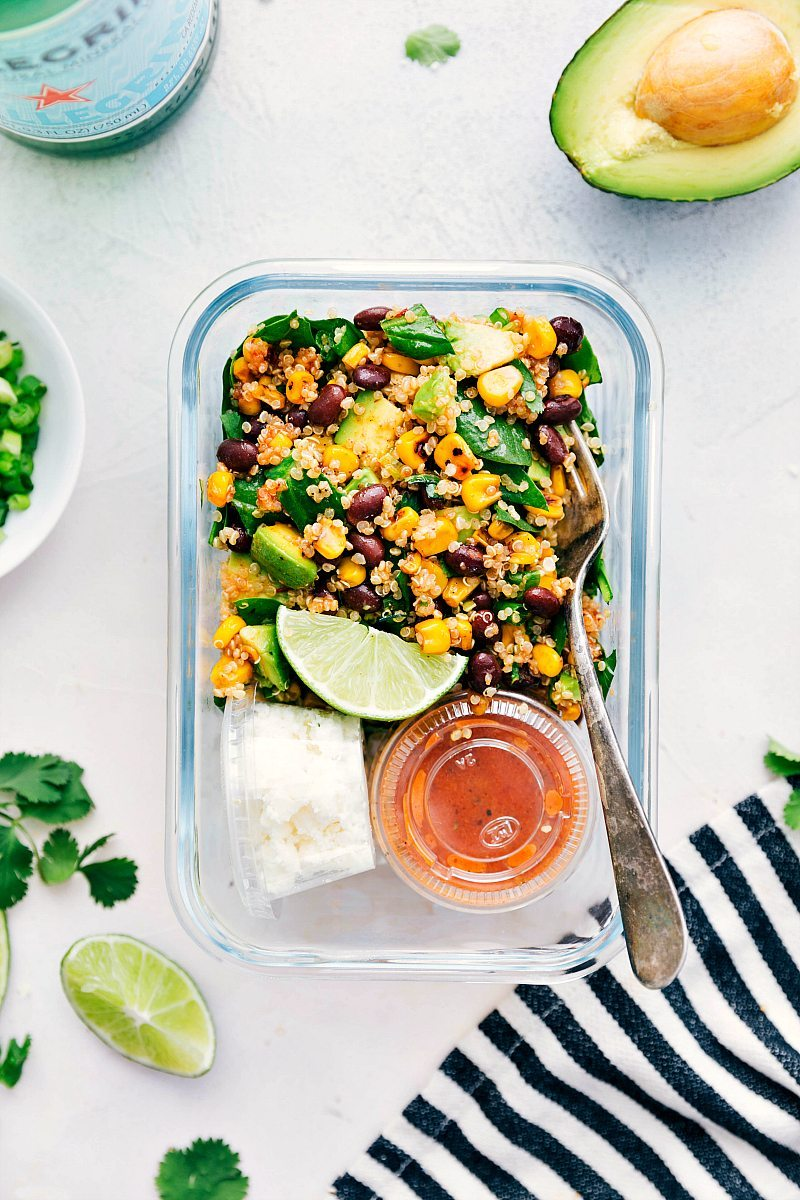 A healthy Mexican-flavor inspired avocado and corn quinoa salad packed with veggies and coated in the most delicious chipotle vinaigrette | chelseasmessyapron.com | #quinoa #salad #healthy #easy #vegetarian #quick #chipotle #dressing #spinach #health #Mexican #corn #avocado #corn #blackbeans #cilantro #greenonions #vinaigrette #mealprep #meal #prep