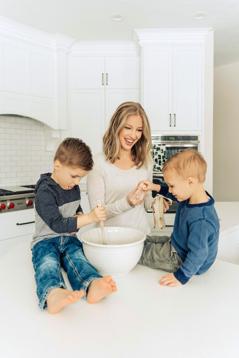 Author baking banana cupcakes in kitchen with 2 boys