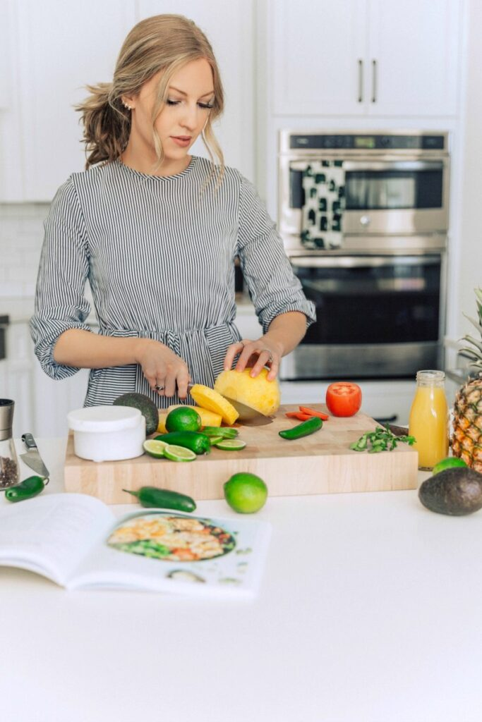 Chelsea chopping vegetables in her kitchen