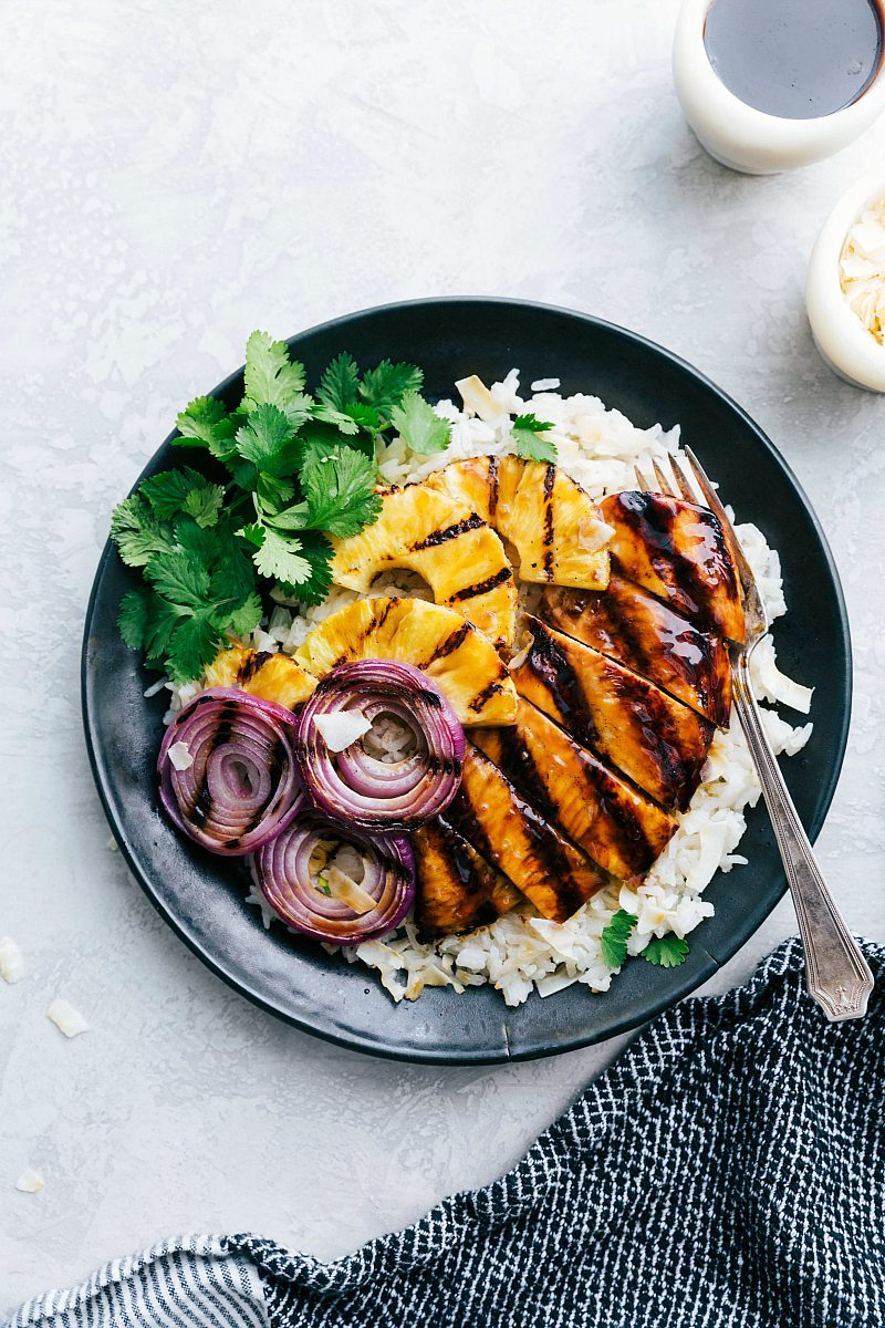 Grilled chicken teriyaki over a coconut rice with grilled pineapple and onion