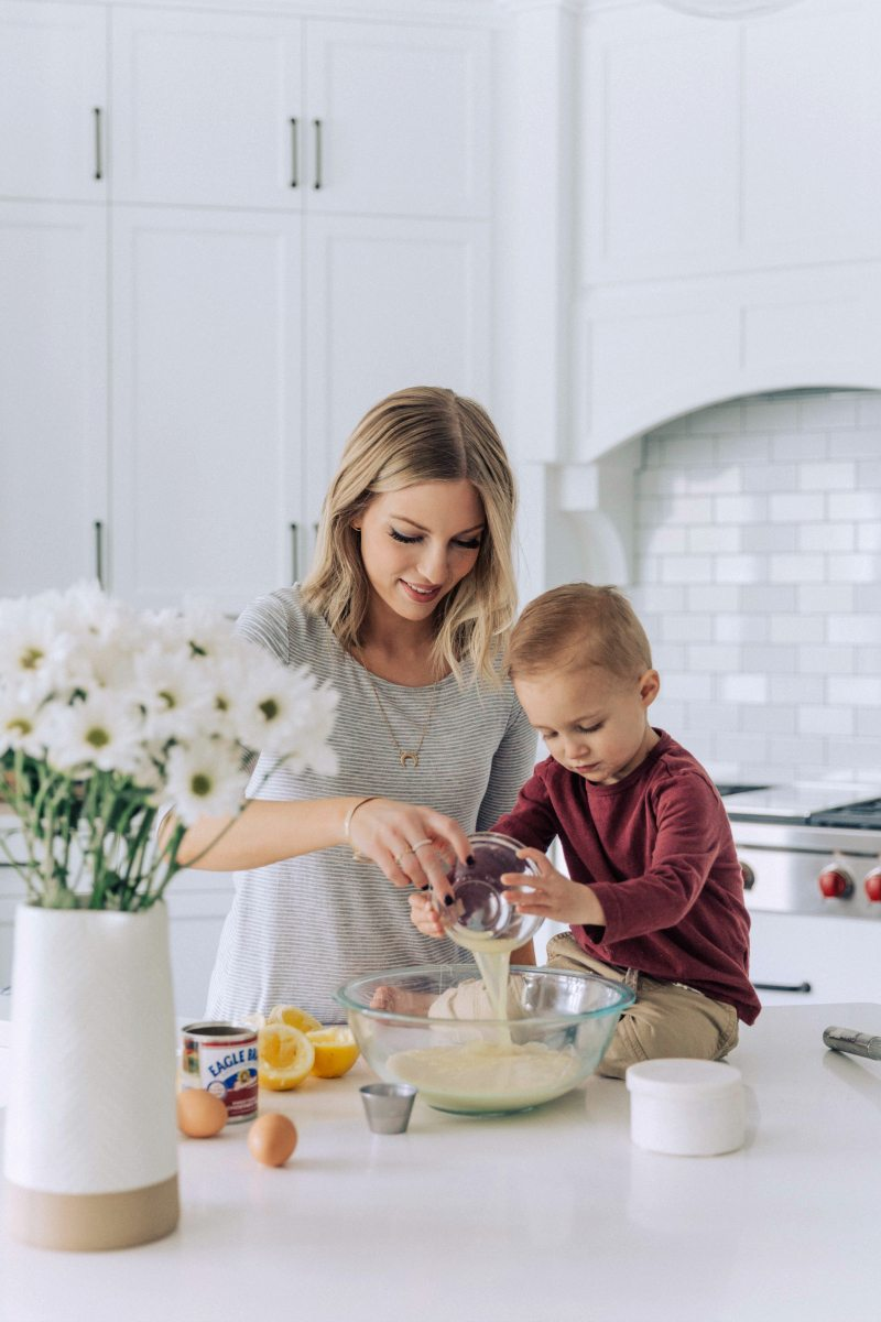Image of Chelsea and her son making the pie