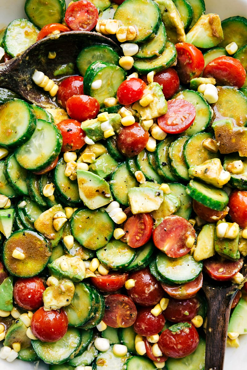 Close up shot of the cucumber salad with avocado, corn, tomato, and a healthy and easy balsamic dressing