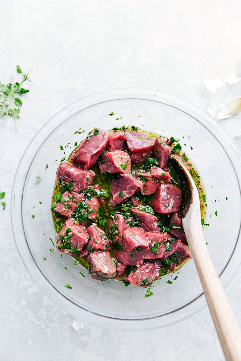 Overhead photo of raw meat in marinade mixture