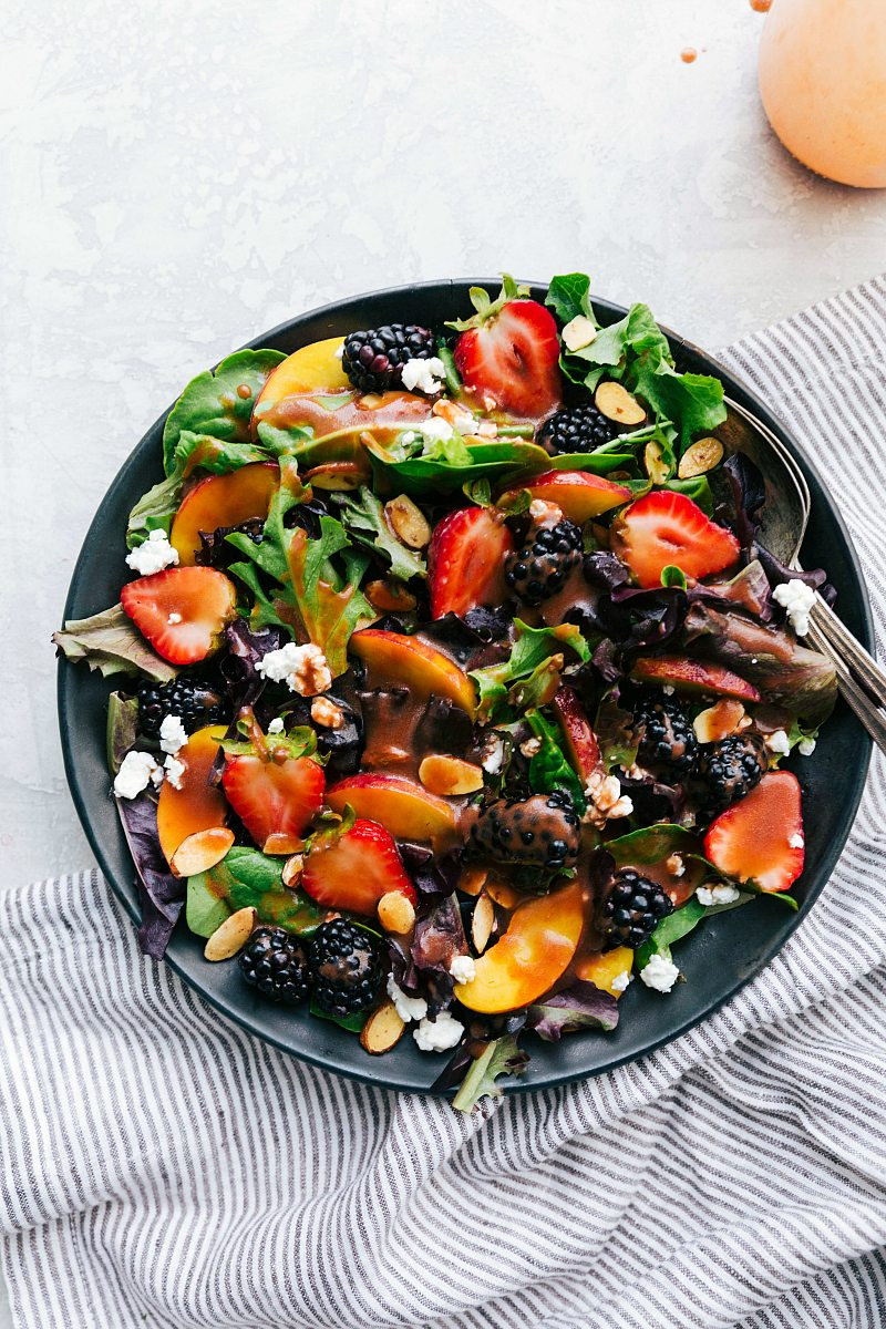 Fresh and flavor packed salad with an incredible strawberry balsamic vinaigrette via chelseasmessyapron.com #strawberry #salad #balsamic #dressing #vinaigrette #easy #quick #healthy #feta #goat #cheese #almonds #best #potluck #peach #peaches #blackberry
