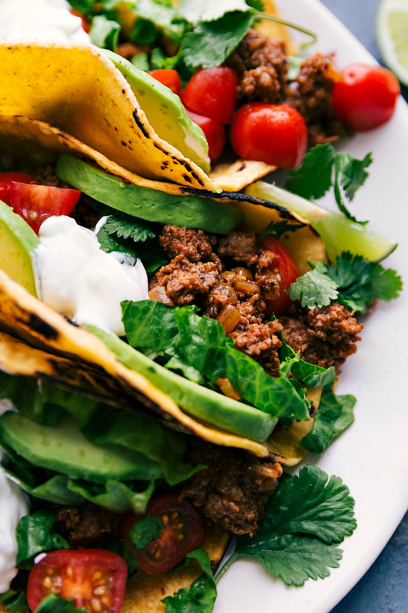 Up close image of the best turkey taco recipe on a plate with all the toppings on and ready to be eaten