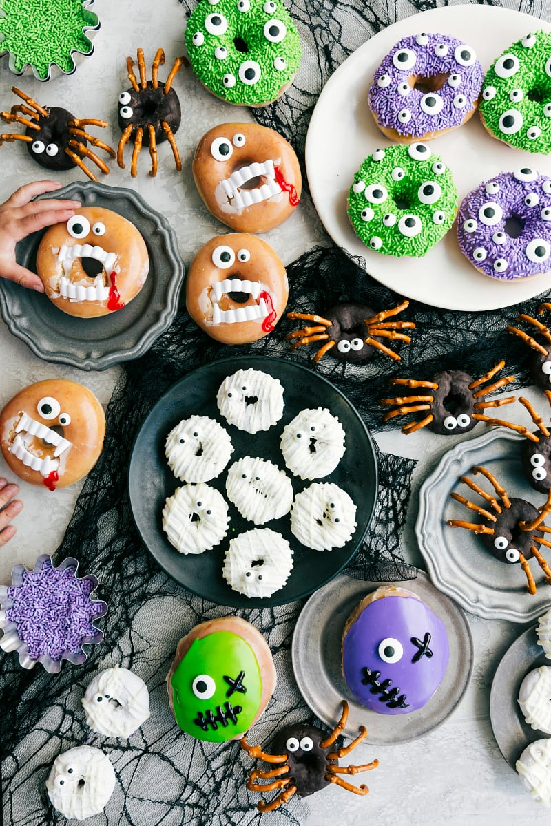 Overhead image of the different Halloween Donut options--the vampire, monster, mummy, spiders, and Frankenstein!