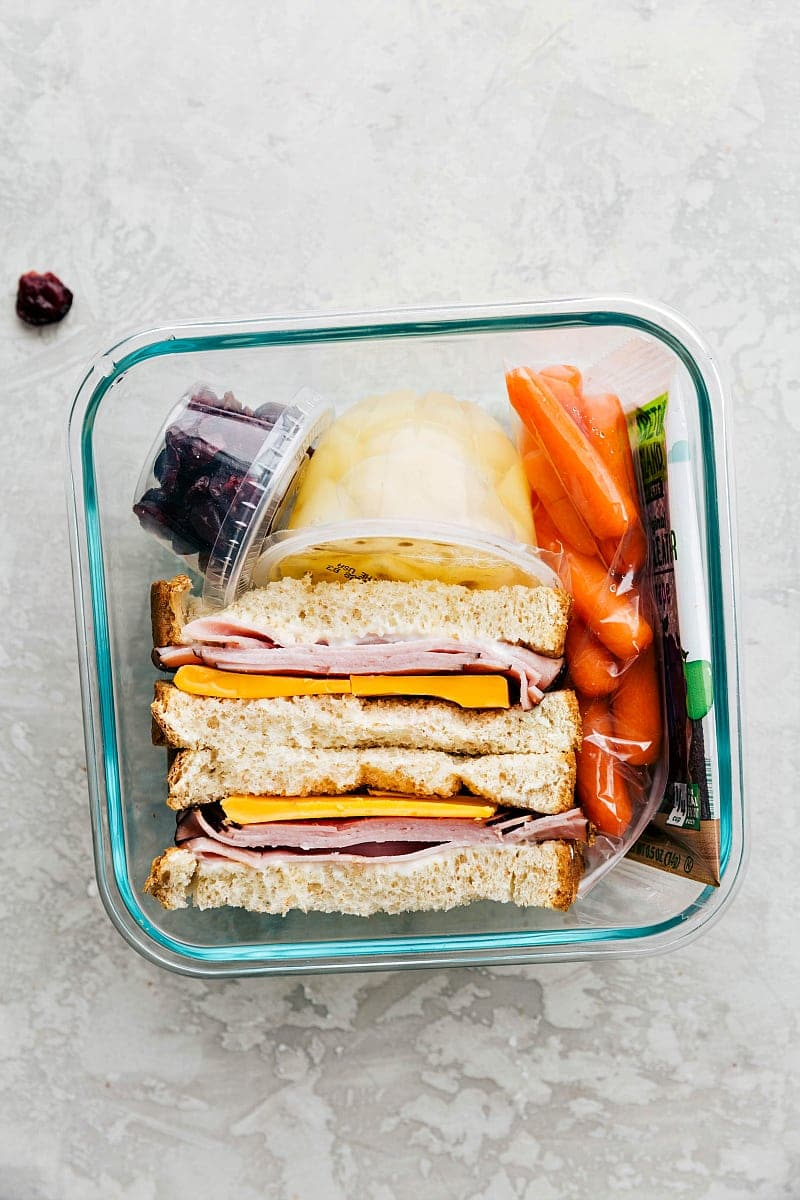School lunch ideas: 5 ideas for healthier (but still simple) lunches. This lunch has packed ham and cheddar sandwich with fruits and veggies