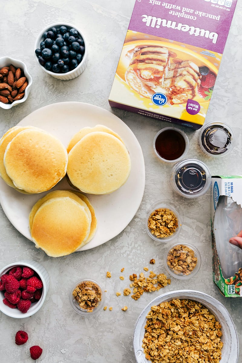Overhead view of pancakes with toppings.