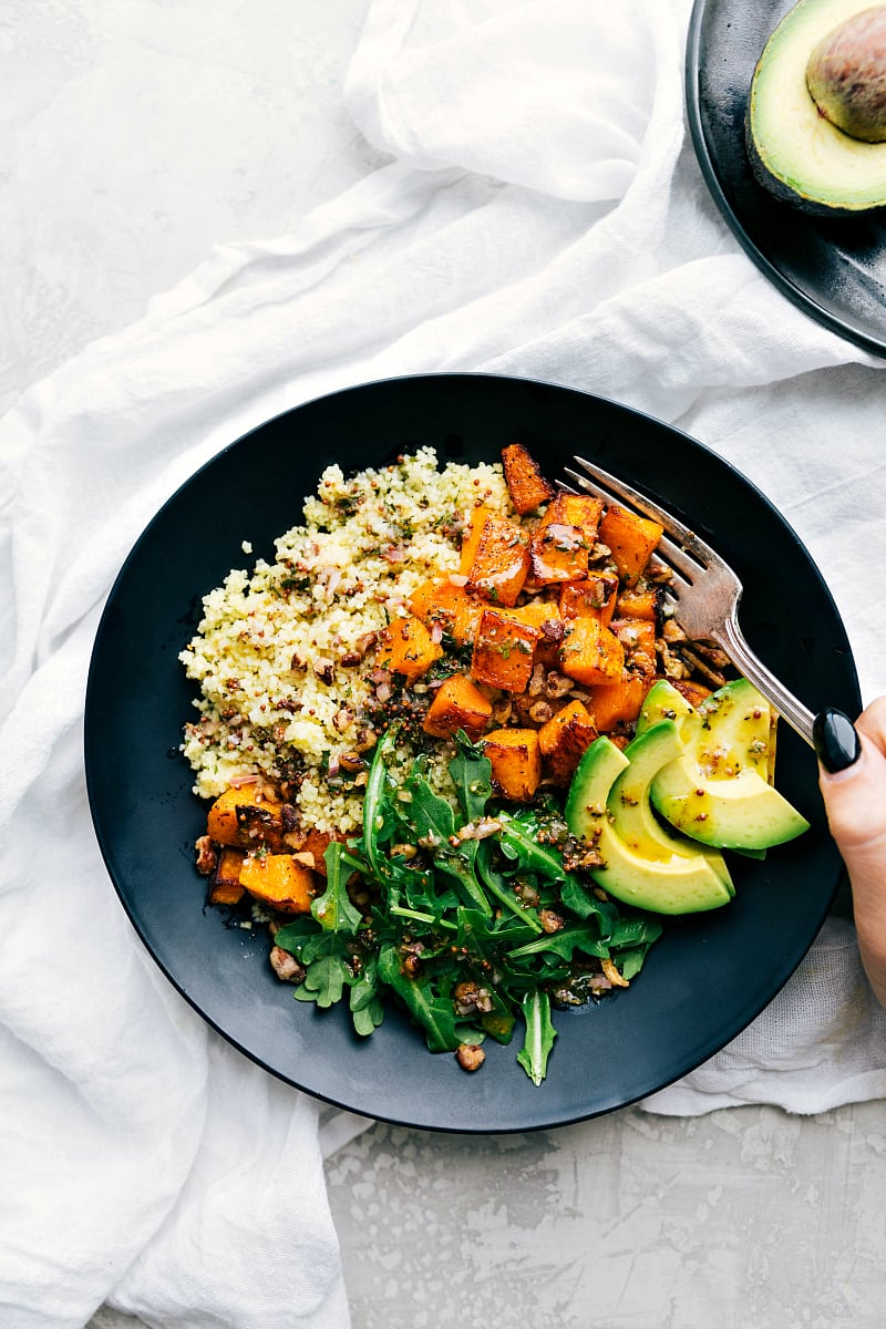 Plate with perfect roasted butternut squash, couscous, and the best dressing! A perfect healthy Fall meal